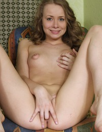 Beauty fondling her pretty stunning teenage body with a toy