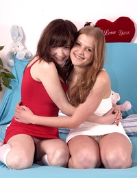 Two teen lesbians like sucking and poking a giant dildo